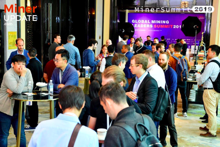 MinerSummit 2019 attendees network outside the main hall.