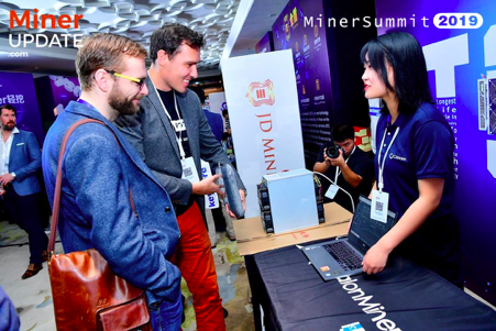 Pavel Moravec and Jan Capek from Slush Pool talk with JD Mining at the sponsorship stands